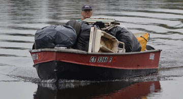 Bob Ludwig with a boat load of trash from the dark side of the Wethersfield Cove