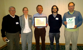 Corrie Folsom-O'Keefe presents IBA certificate to Jim Woodworth, Tom Kehoe, Chris Duff and Larry Lunden